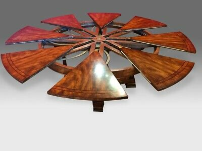 Amazing 5ft to 7.11 Sunburst Flame mahogany Jupe circular Grand dining table.