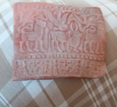 an ancient near eastern terracotta roll seal tablet