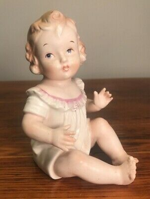 Antique German Bisque Piano Baby Doll Figurine