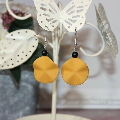 Silver drop earrings with mustard yellow wavy focal bead, and black crystal
