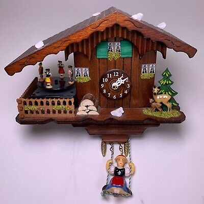 Kuckulino Black Forest Cuckoo Clock Swiss quartz movement - Lumberjack Scene