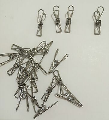 Metal clothes pegs