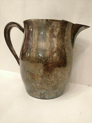 Academy silver on copper pitcher