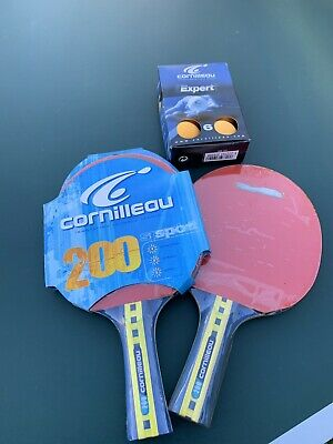 Two New Unused Cornilleau 200 Table Tennis Bats And a Box Of 6 New Yellow Balls