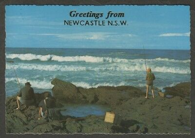e1657)   GREETINGS FROM NEWCASTLE NSW  MV POSTCARD  -  FISHING OFF THE ROCKS