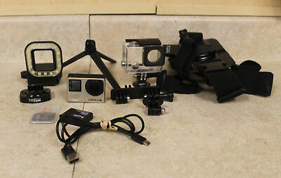 GoPro Hero 4 with 64GB SD Card Extra Battery and Other Accessories