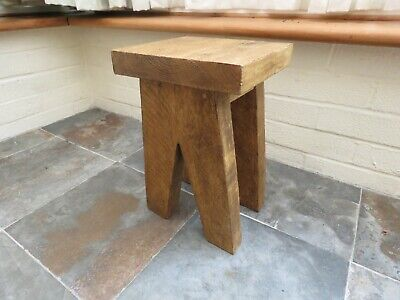 Small side table in style of a milking stool made from reclaimed scaffold board