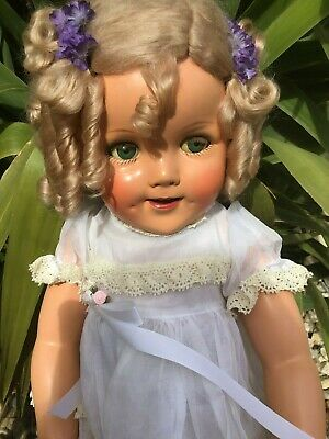 Very rare Shirley Temple composition doll 27'. Fully restored and comes derssed