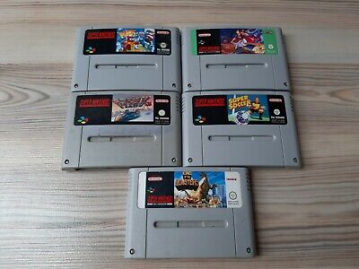 Super Nintendo SNES Spiele Kult Games Aladdin King of Monsters FZero Plock Modul