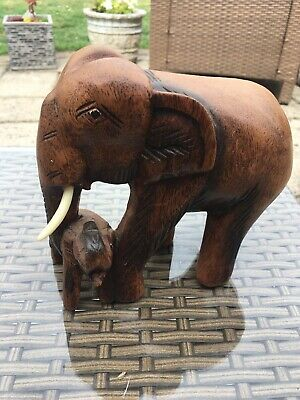 large carved wooden elephant and baby hand carved elephant
