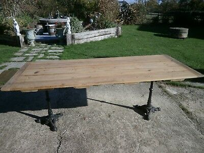Antique pine table with twin pedestal cast iron legs