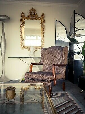 A vintage comfortable wing chair English Period Classic Victorian Interior
