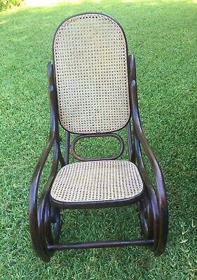 Antique Bentwood Caned Rocking Chair.