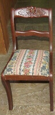 Child's antique wood chair with rose-back, upholstered