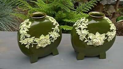 Pair of beautiful old green moon vases with flower relief on 4 feet
