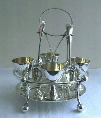 A BEAUTIFUL VINTAGE SILVER PLATED EGG CUP HOLDER AND SPOONS with Makers Marks
