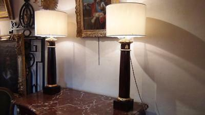 Pair of Empire period in rosewood veneer columns, gilded bronze and wood