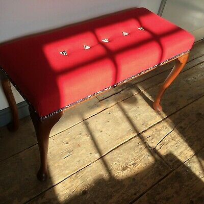 Window seat/long stool, red with African print piping and triangular buttons...
