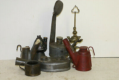 7 small whale oil lamps, 6 tin, one brass, 2 have paint,all have tops,circa 1850