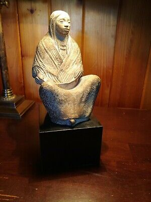Stone Sculpture of Native American Woman