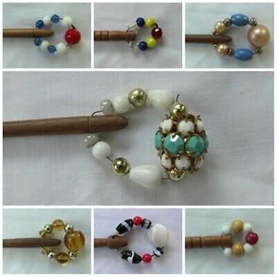 7 Antique  wooden bobbins carved and spangled with beads