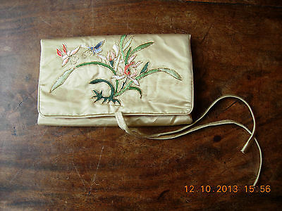 Gold Chinese silk jewellery roll with embroidered flowers and butterflies