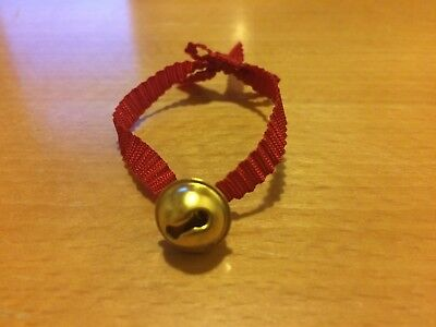 Tiny bell on red ribbon