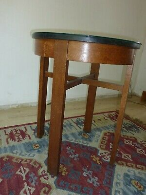 "1930s pub table with bakelite and glass top. 30"" high 24"" diameter."