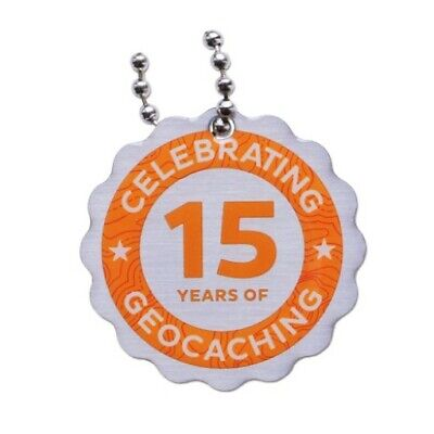 15 years of Geocaching trackable tag / travel bug - new, packaged + unactivated