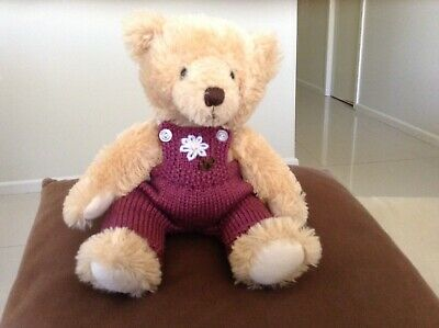 hand knitted teddy bear clothes to fit a 30cm teddy. Dungarees with embroidered