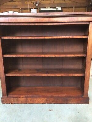 antique walnut bookcase with three shelves