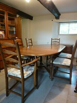Ercol extending dining room table and 6 chairs