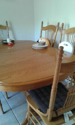 Solid oak dining table with 6 chairs good condition
