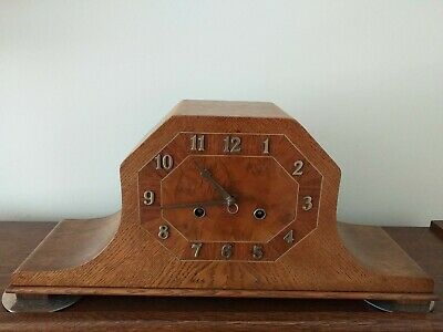 Superb 8 day1930s Junghans mantel Clock in oak  and walnut Excellent Condition.