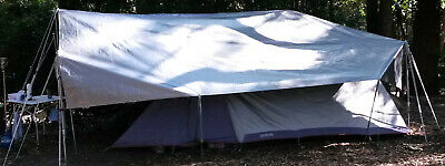 Complete Camping over tarp set. Includes tarp, poles, ropes, pegs & bag Near new