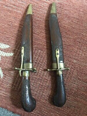 Very old knife with brass and wooden case
