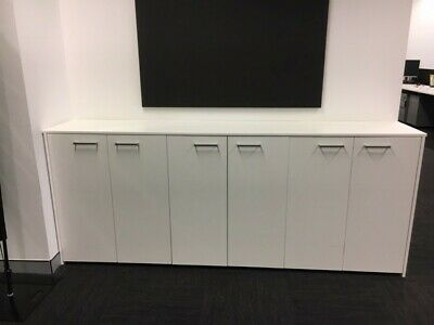 Strorage cabinet with 3 shelves in each cupboard. Pick up only. Great condition.