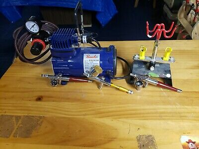 Paasche airbrush compressor with 3 airbrushes 1 Talon gravity feed and 2 Vl