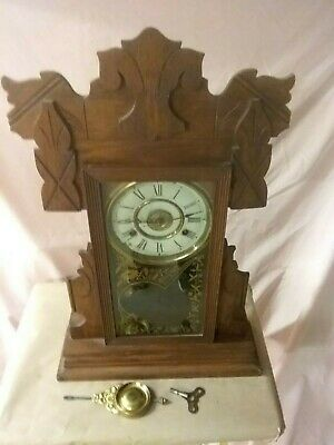 Vintage New Haven 8 day key wind clock with with alarm, key and pendulum