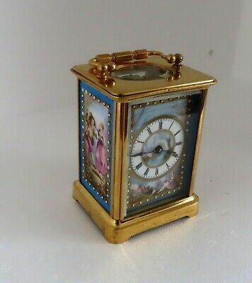 Gilt brass French Carriage Clock with Sevres panels Late 19thC