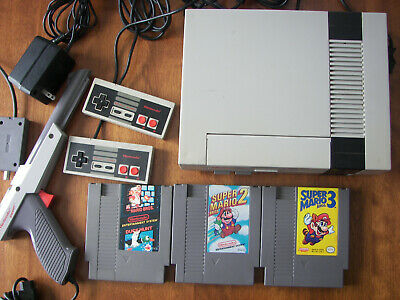 nintendo nes action set system complete with zapper and Super Mario Bros. 1,2,3
