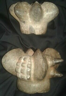 2 Stone mace head of preColumbian Chavin carved in the  Moche