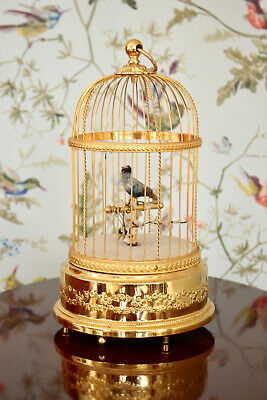 A Magnificent Reuge Sainte-Croix Singing Bird Automaton in Gilded Cage