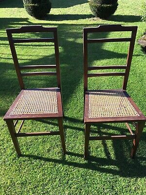 A Pair of Edwardian Wooden Antique Bedroom or Hall Chairs with cane seats