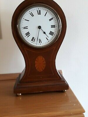 Balloon mantle clock with inlaid decoration and brass feet. Working with key.