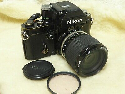 Nikon F2 35mm SLR Camera with 43 86mm lens + caps + filter ..fully working