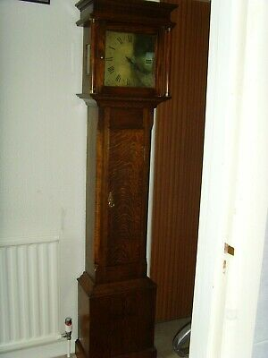 Good quality Oak long cased clock with solid brass face