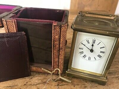 Antique C20th brass carriage-clock with leather travelcase in original condition