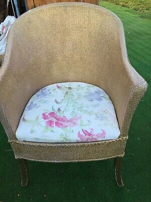 Vintage Lloyd Loom wicker type comode chair with floral cushion
