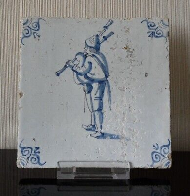 Very rare 17th C. Dutch Delft blue & white wall tile depicting a bagpipe player.